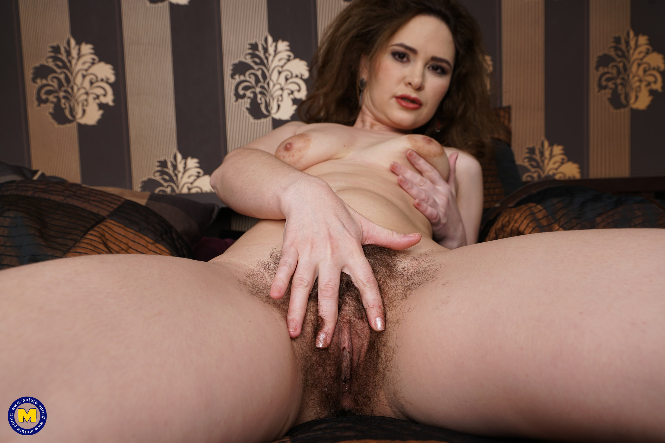 Utterly hairy housewife toying with her cooch