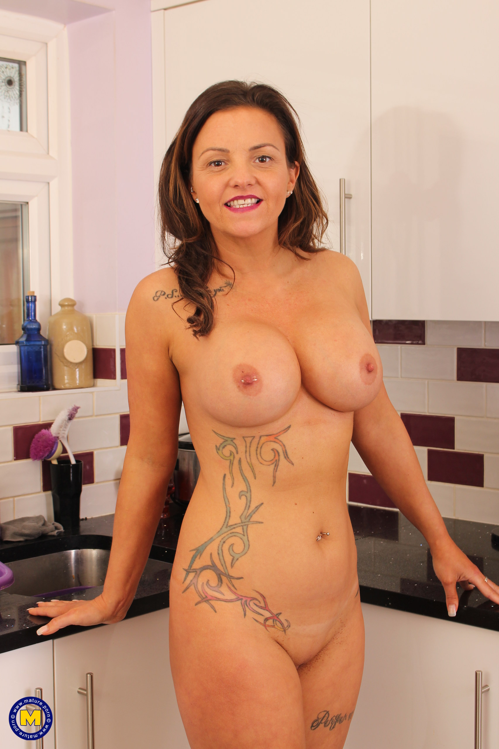 Sizzling Brit MILF playing with herself in the kitchen