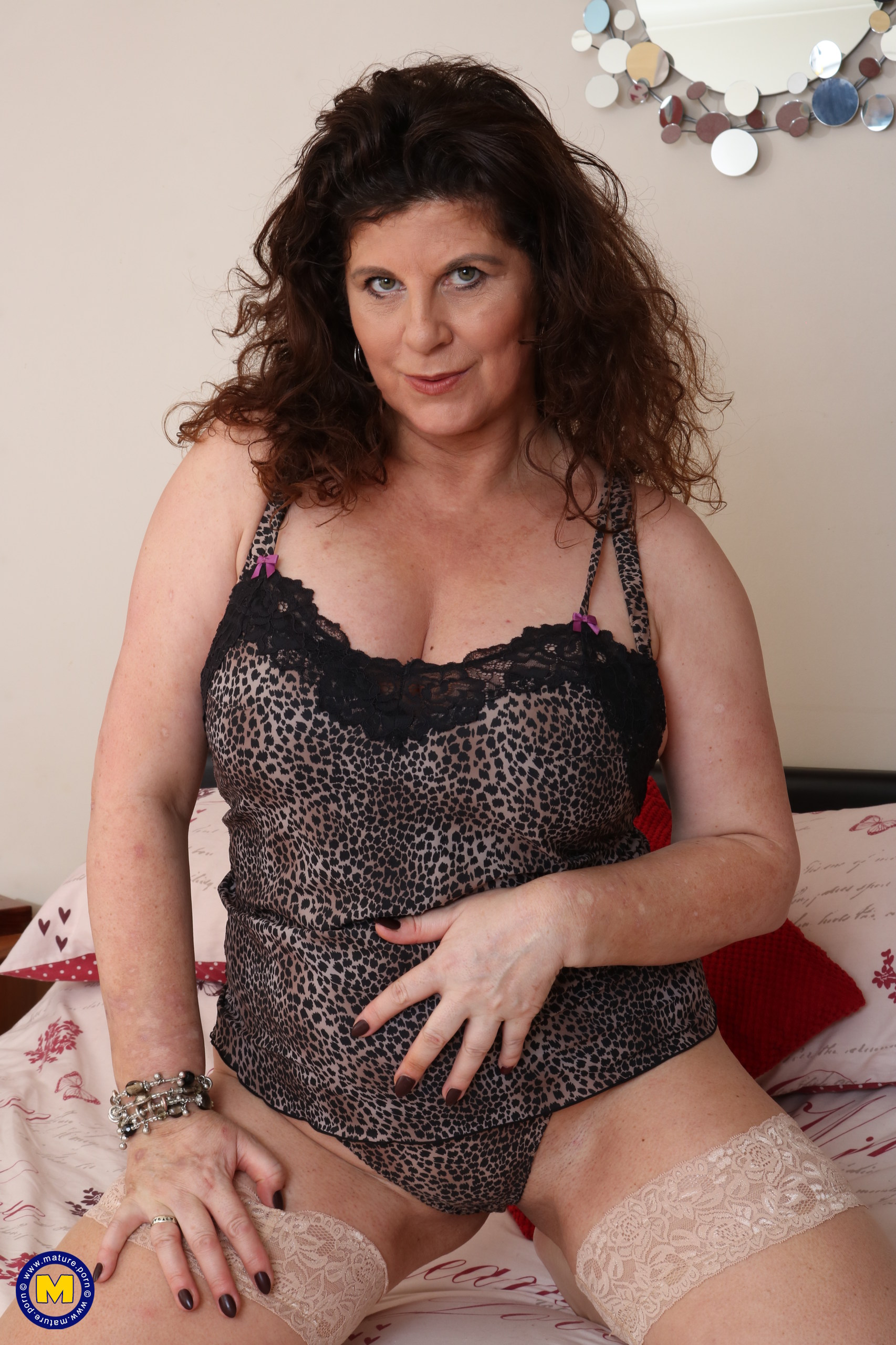 Wild Brit housewife toying with her honeypot