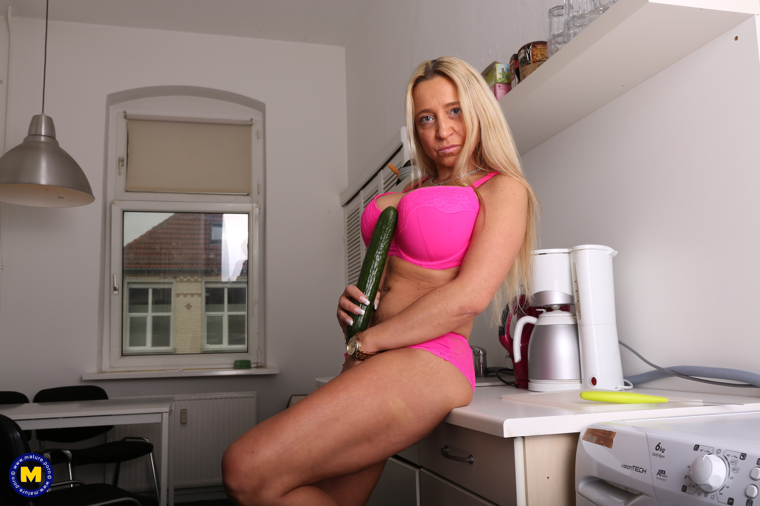 Horny German mummy toying in her kitchen with her cucumber