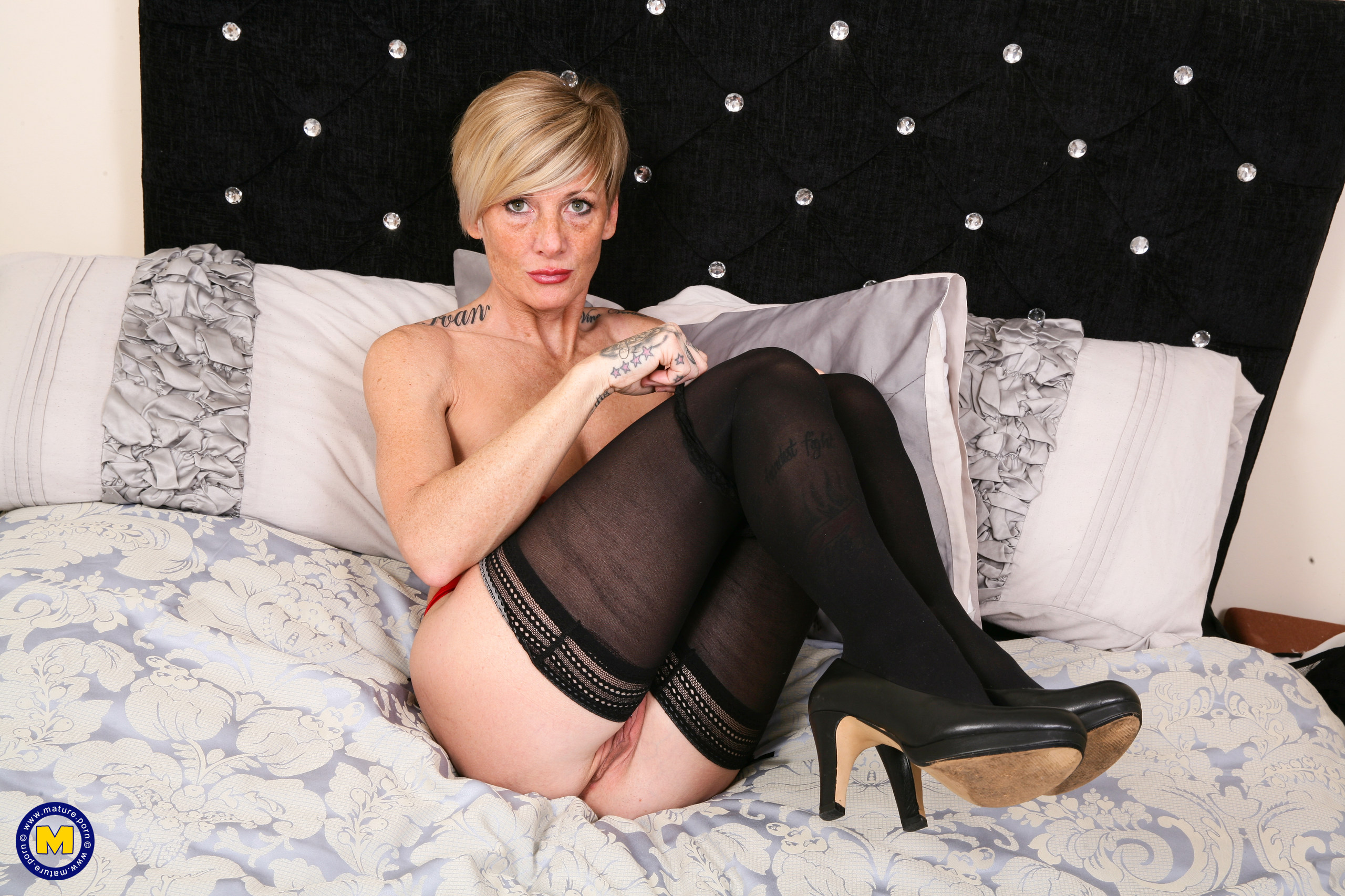 Mischievous pierced British mother toying with her toy